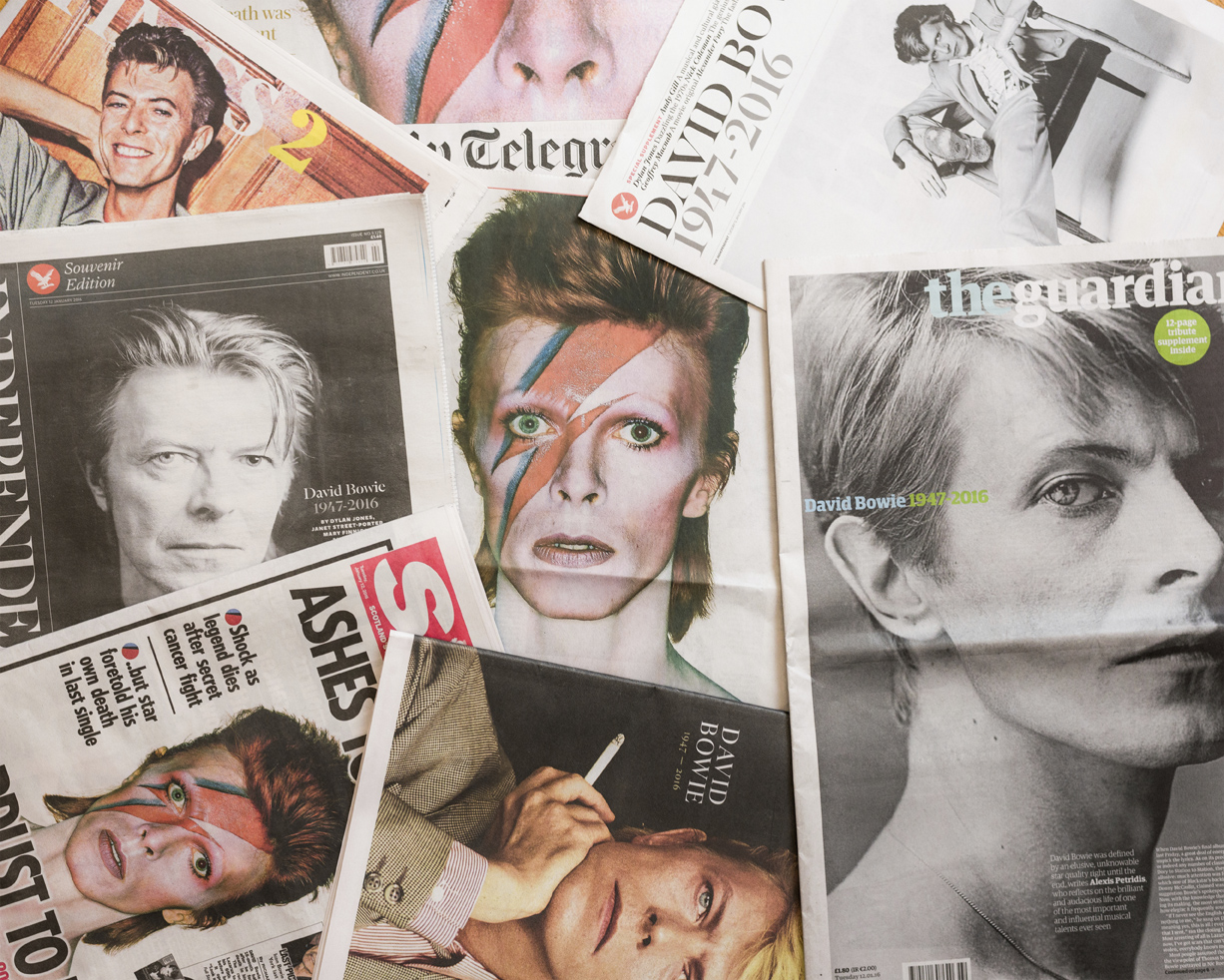 Edinburgh, UK - January 12, 2016: The front pages of several British newspapers, published following the death of David Bowie on 10th January 2016.  UK newspaper front pages featuring images of David Bowie with news of his death on 10th January 2016.  All artist royalties from sales of this file and others in the lightbox linked to below are donated to Oxfam, an international charity committed to finding lasting solutions to poverty and related injustice around the world.  Please click [url=http://istockpho.to/OxfamDonationLightbox]here[/url] to see the files in the Oxfam Donation lightbox.  Lightbox royalties donated to 1st August 2015: GBP 1,823.56 (USD 2,850.88) Next date for donations: 1st August 2016