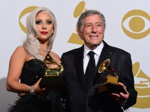 "Lady Gaga and Tony Bennett hold their Grammys for Best Traditional Pop Vocals for their album ""Cheek to Cheek"" in the press room during the 57th annual Grammy Awards in Los Angeles, California on February 8, 2015. AFP PHOTO / FREDERIC J. BROWN (Photo credit should read FREDERIC J. BROWN/AFP/Getty Images)"